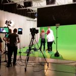 Steve Lord Lighting Cameraman filming green screen on set